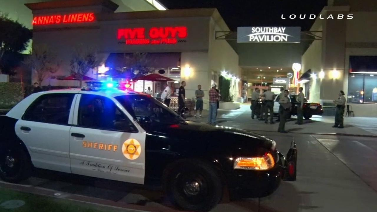 Los Angeles sheriffs deputies respond to a shooting occurred outside a Chuck E. Cheeses in Carson on Saturday, Oct. 18, 2014.