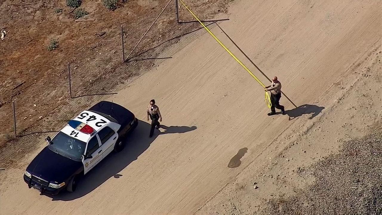 Sheriffs deputies investigate after a body was found in the area of the 605 Freeway and Valley Boulevard in Bassett on Monday, Oct. 20, 2014.