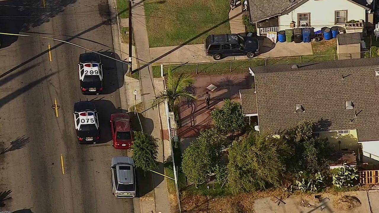 Los Angeles County sheriffs deputies respond to a home in the 100 block of North Gage Avenue in East Los Angeles Monday, Oct. 20, 2014.