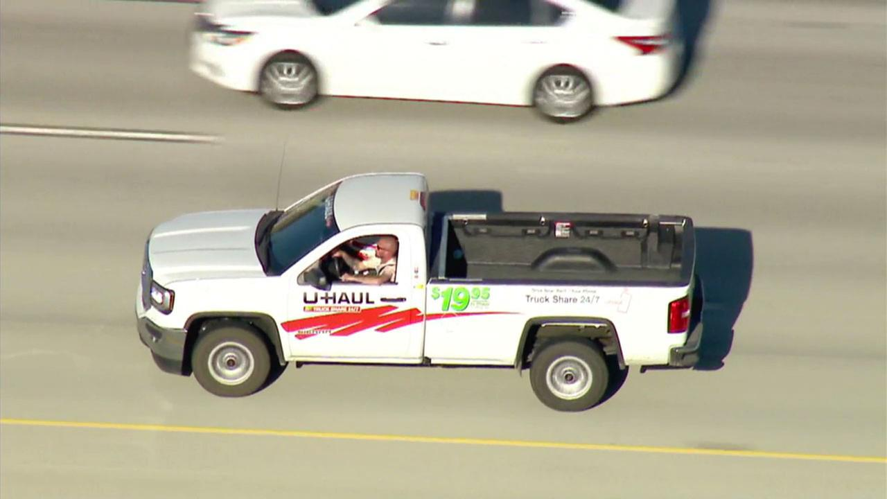 A suspect in a U-Haul pickup truck is shown fleeing from authorities on a freeway in San Bernardino County on Wednesday, June 13, 2018.