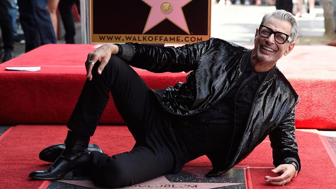Actor Jeff Goldblum poses astride his star on the Hollywood Walk of Fame.