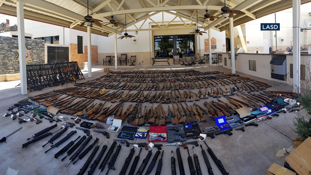 Los Angeles County sheriffs deputies and federal agents seized more than 550 firearms from a convicted felon in Agua Dulce.