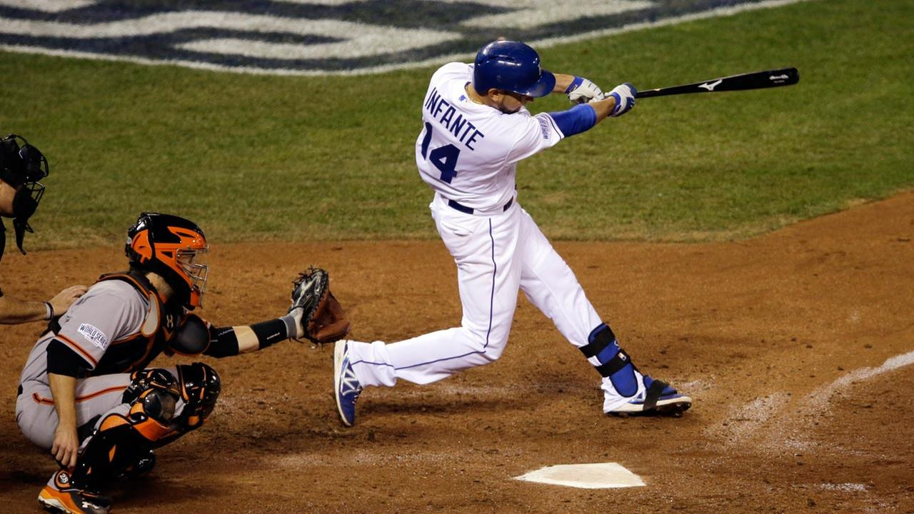 Kansas City Royals Omar Infante hits a two-run home run during the sixth inning of Game 2 of baseballs World Series against the San Francisco Giants Wednesday, Oct. 22, 2014.