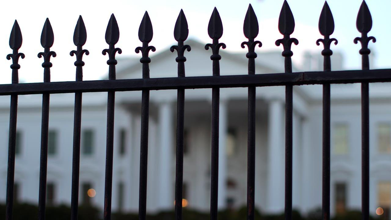 The White House is seen through the North Lawn perimeter fence in Washington, Tuesday, Sept. 23, 2014.