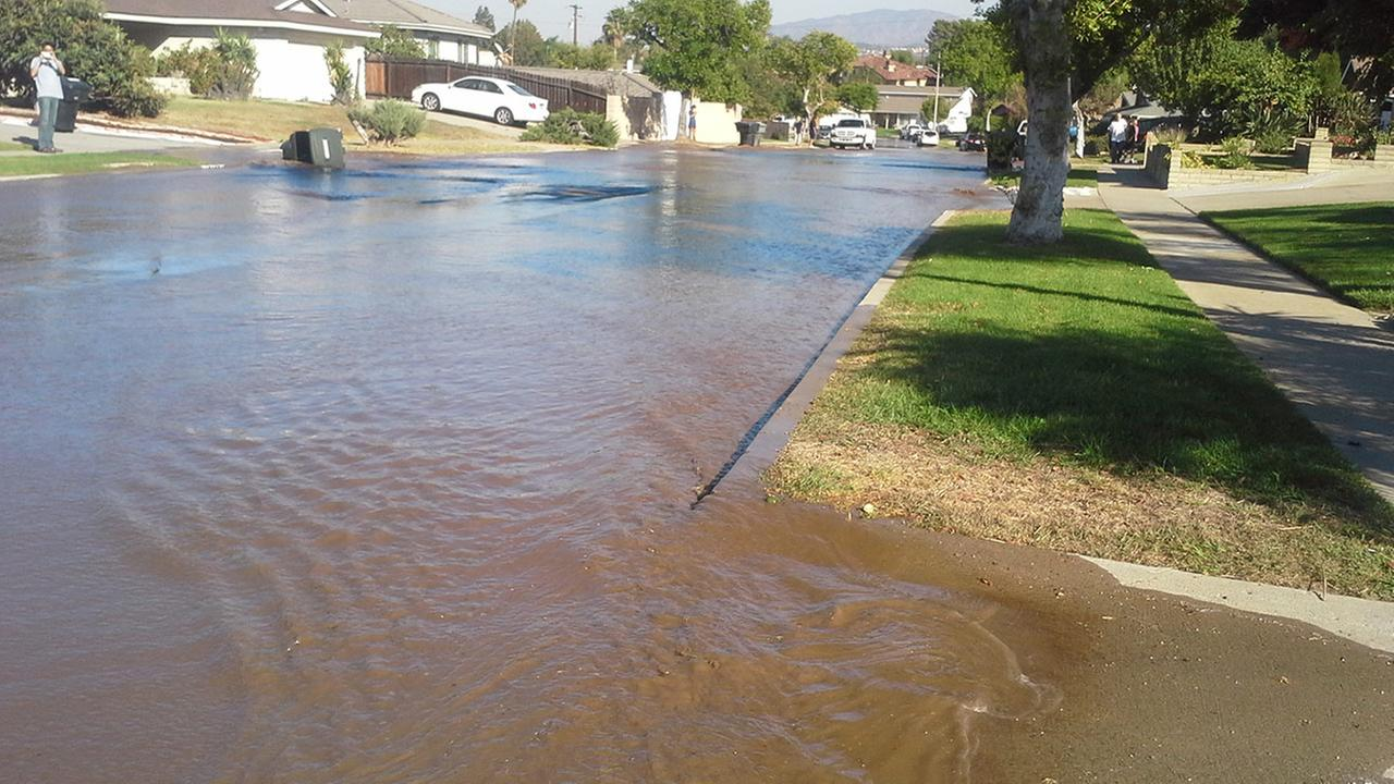 An Anaheim neighborhood was flooded after a water main burst on Thursday, Oct. 23, 2014.