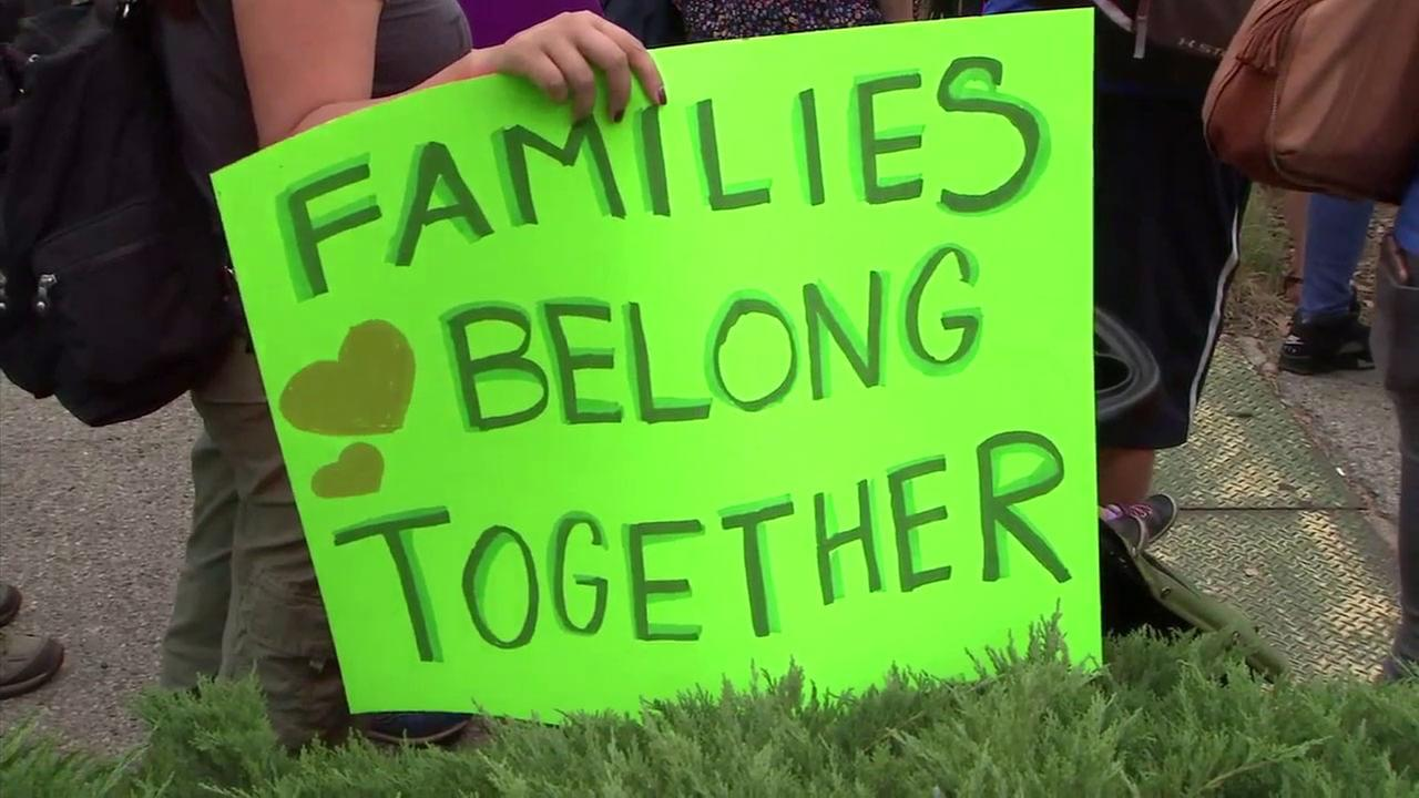 A sign that states Families belong together is shown during a protest over the Trump administrations zero-tolerance policy in Westwood on Saturday, June 23, 2018.