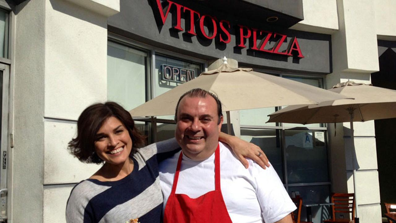 Posing outside Vitos Pizza in Los Angeles.