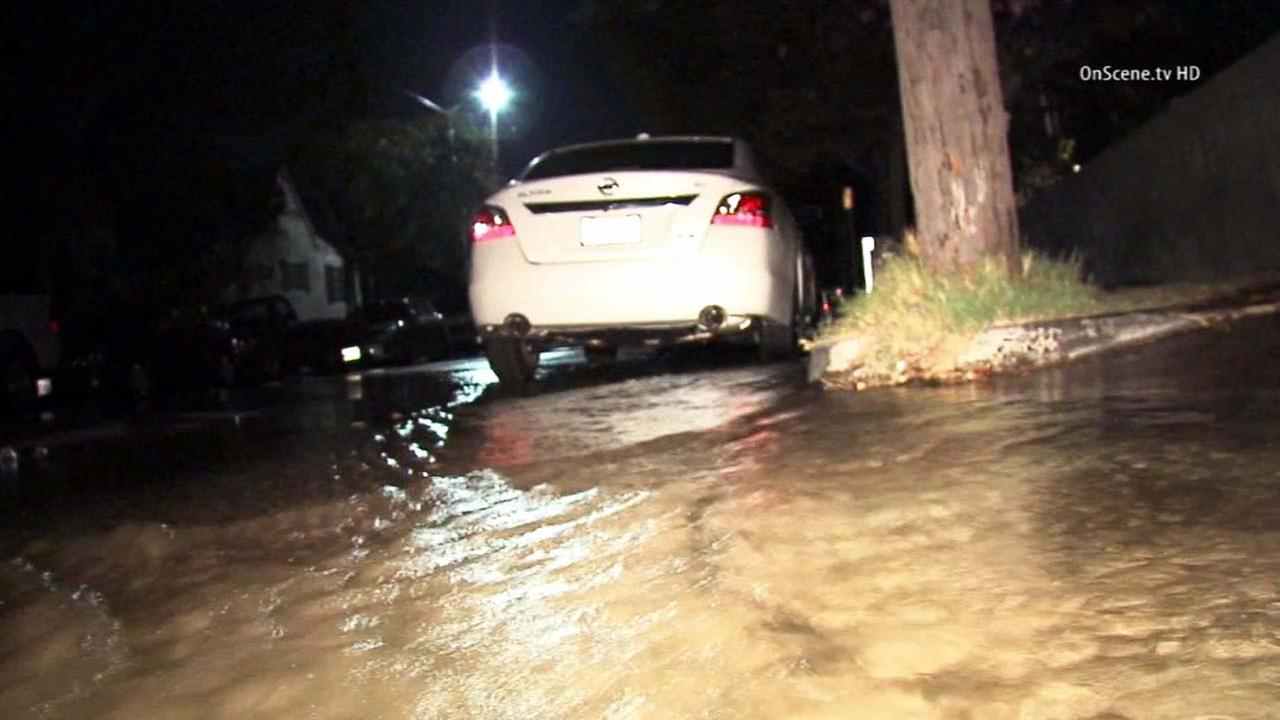 A broken water main was to blame for flooding along the 900 block of North Heliotrope Drive in Hollywood on Saturday, Oct. 25, 2014.