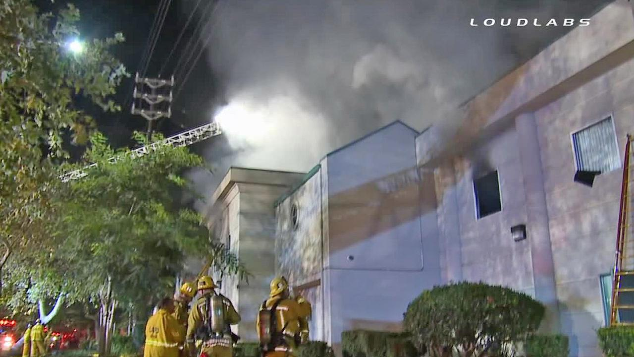 Firefighters at the scene of a major fire in Venice on Saturday, Oct. 25, 2014.