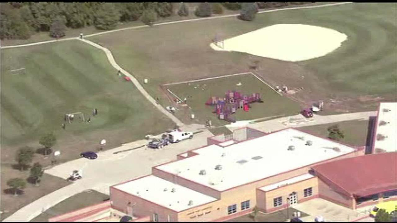 2 shot at Kansas elementary school; gunman at large