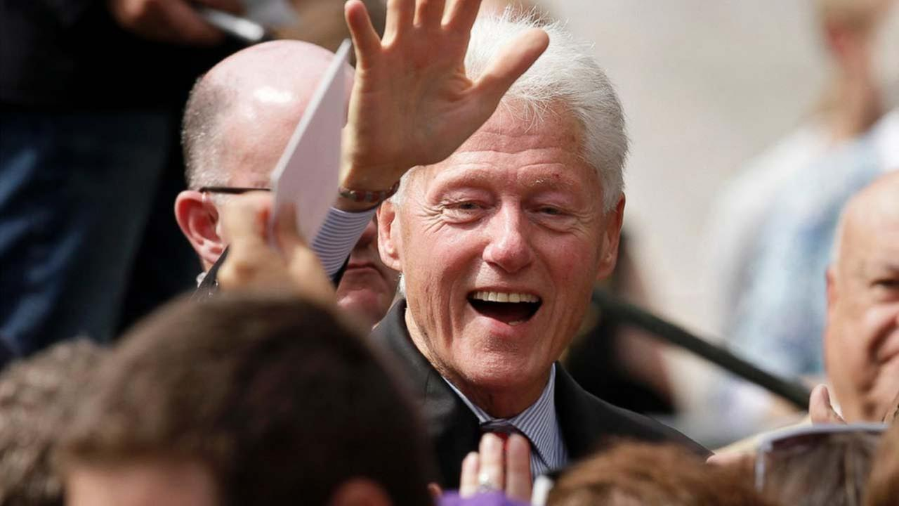In this photo taken Oct. 6, 2014, former President Bill Clinton greets supporters after a political rally at the University of Central Arkansas in Conway, Ark.