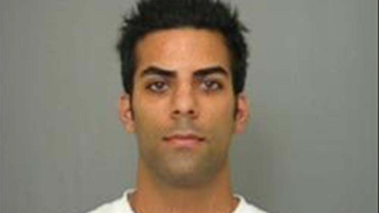Arman Lotfi, a suspected wedding thief, is seen in a booking photo from the Tustin Police Department.
