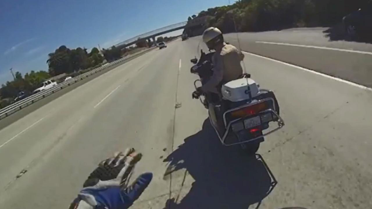 Authorities have arrested the motorcycle rider suspected of filming and waving off a California Highway Patrol officer who was trying to stop him and other riders.
