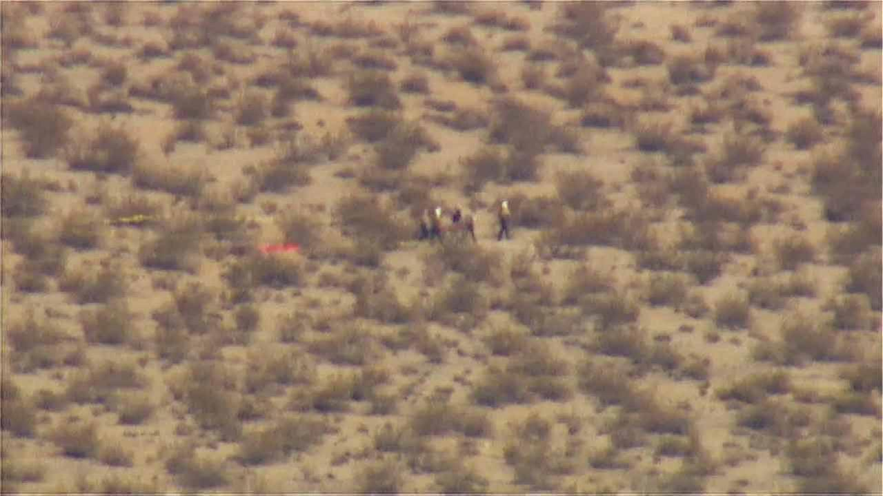 A rescue team is shown at the scene where Virgin Galactics SpaceShipTwo space tourism rocket crashed in the Mojave Desert on Friday, Oct. 31, 2014.