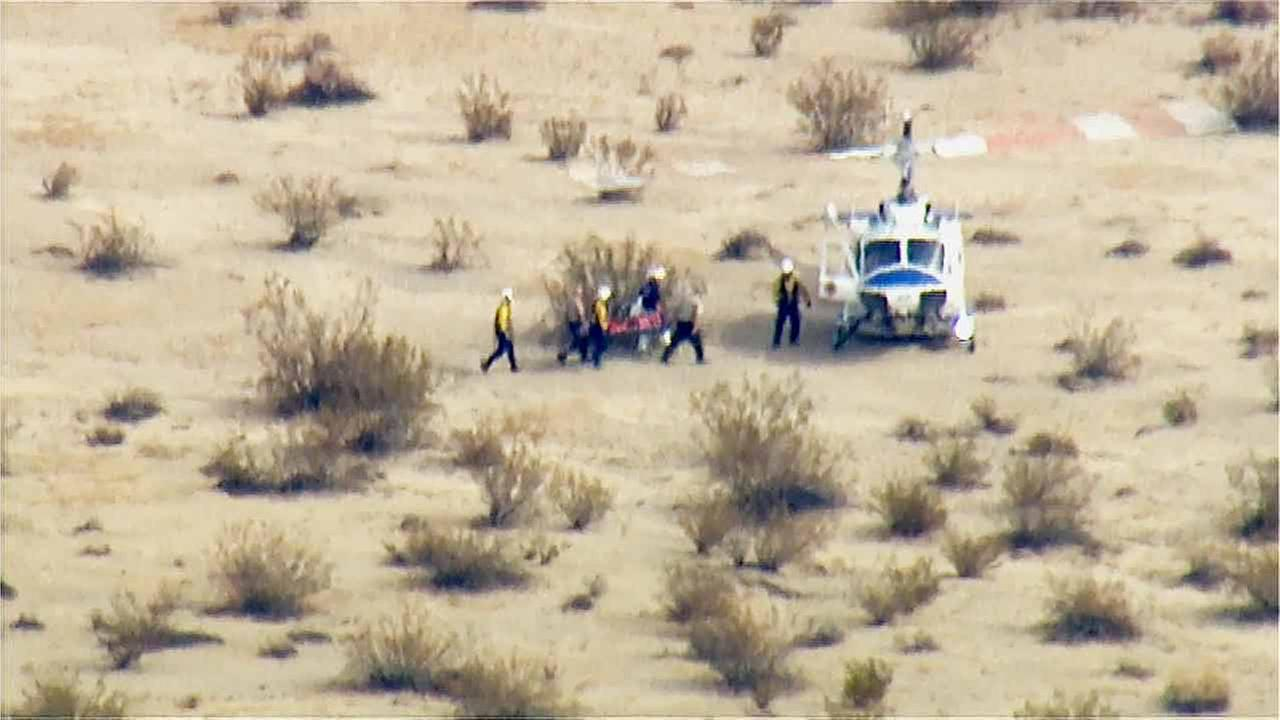 A rescue team is shown at the scene where Virgin Galactics SpaceShip Two space tourism rocket crashed in the Mojave Desert on Friday, Oct. 31, 2014.