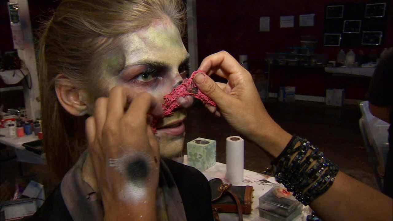 ABC7s Bri Winkler got into the Halloween spirit by undergoing a zombie makeover at Queen Marys Dark Harbor on Friday, Oct. 31, 2014.