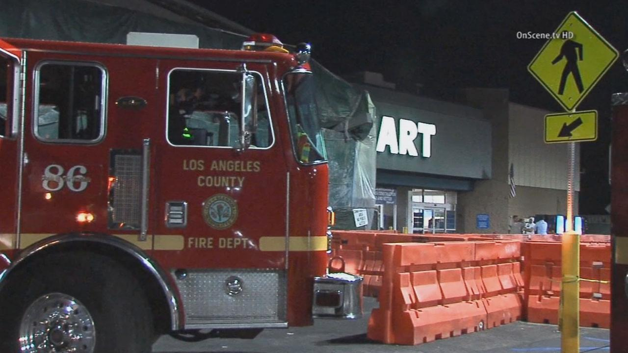 Firefighters respond to a fire at a Walmart store in Glendora on Wednesday, Nov. 5, 2014.