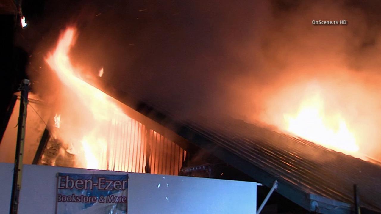 Flames engulfed a religious bookstore near MacArthur Park on Friday, Nov. 7, 2014.