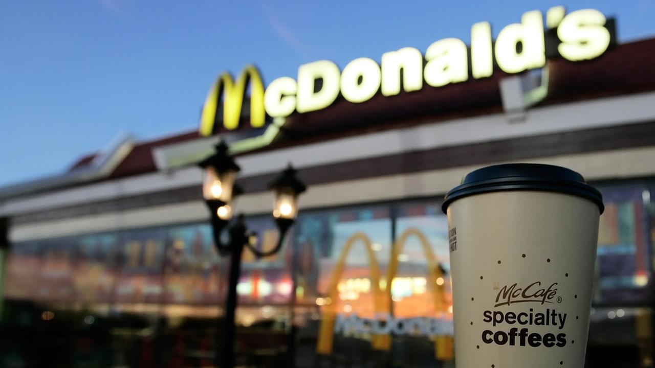 A cup of McDonalds specialty coffee is seen in front of a McDonalds restaurant in Kansas City, Mo., Friday, Nov. 16, 2007.