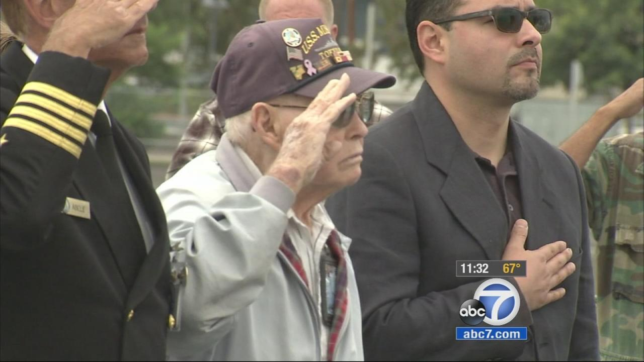 Ernest Thompson, 97, of Gardena, salutes at a ceremony held on the USS Iowa on Tuesday, Veterans Day, Nov. 11, 2014, in San Pedro.