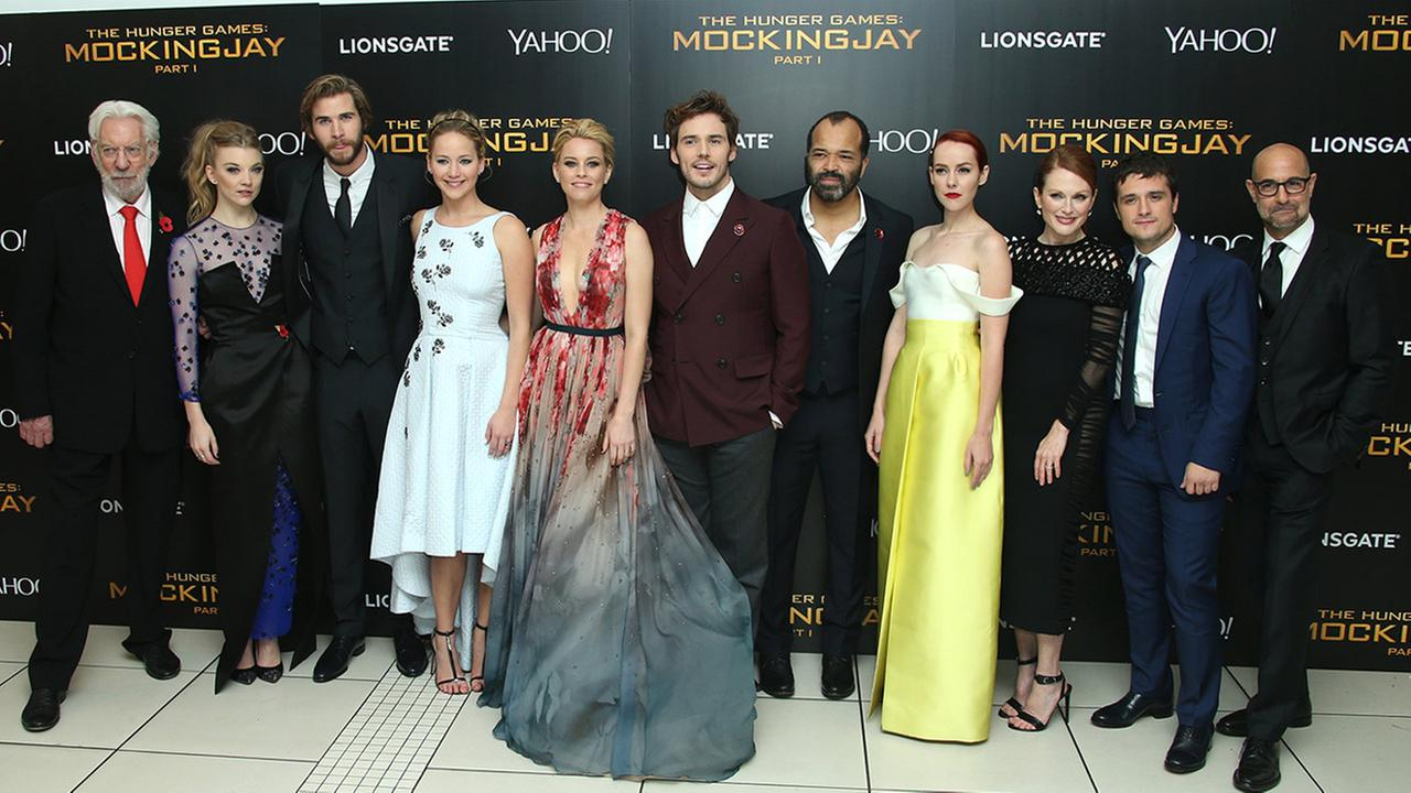 Donald Sutherland, Natalie Dormer, Liam Hemsworth, Jennifer Lawrence, Elizabeth Banks, Sam Claflin, Jeffrey Wright, Jena Malone, Julianne Moore, Josh Hutcherson and Stanley Tucci at the world premiere of The Hunger Games: Mockingjay Part 1 in London.