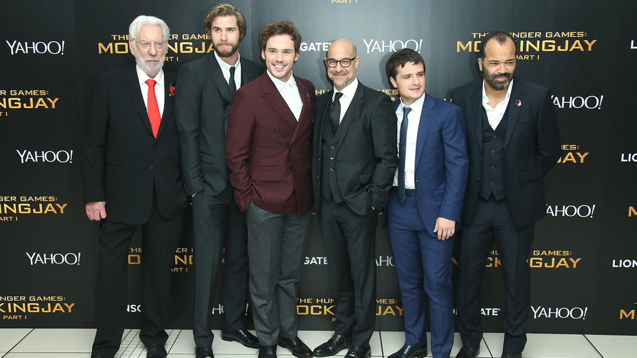 Donald Sutherland, Liam Hemsworth, Sam Claflin, Stanley Tucci, Josh Hutcherson and Jeffrey Wright pose for photographers upon arrival to the world premiere of The Hunger Games: Mockingjay Part 1 in London, Monday, Nov. 10, 2014. Joel Ryan/Invision/AP