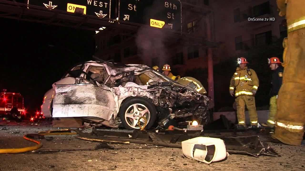 Firefighters on scene of a fatal crash on the southbound 110 Freeway in downtown Los Angeles on Thursday, Nov. 13, 2014.
