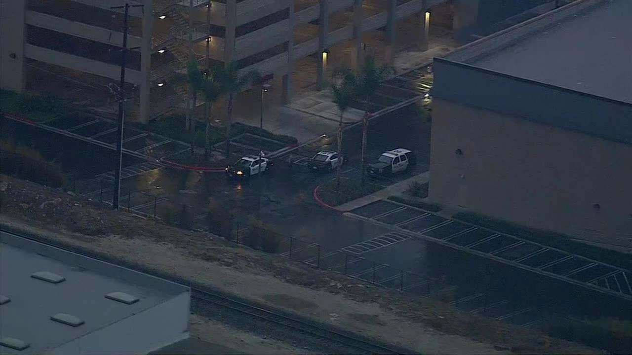 Police surround the South Gate Towne Center after reports of a suspicious backpack.