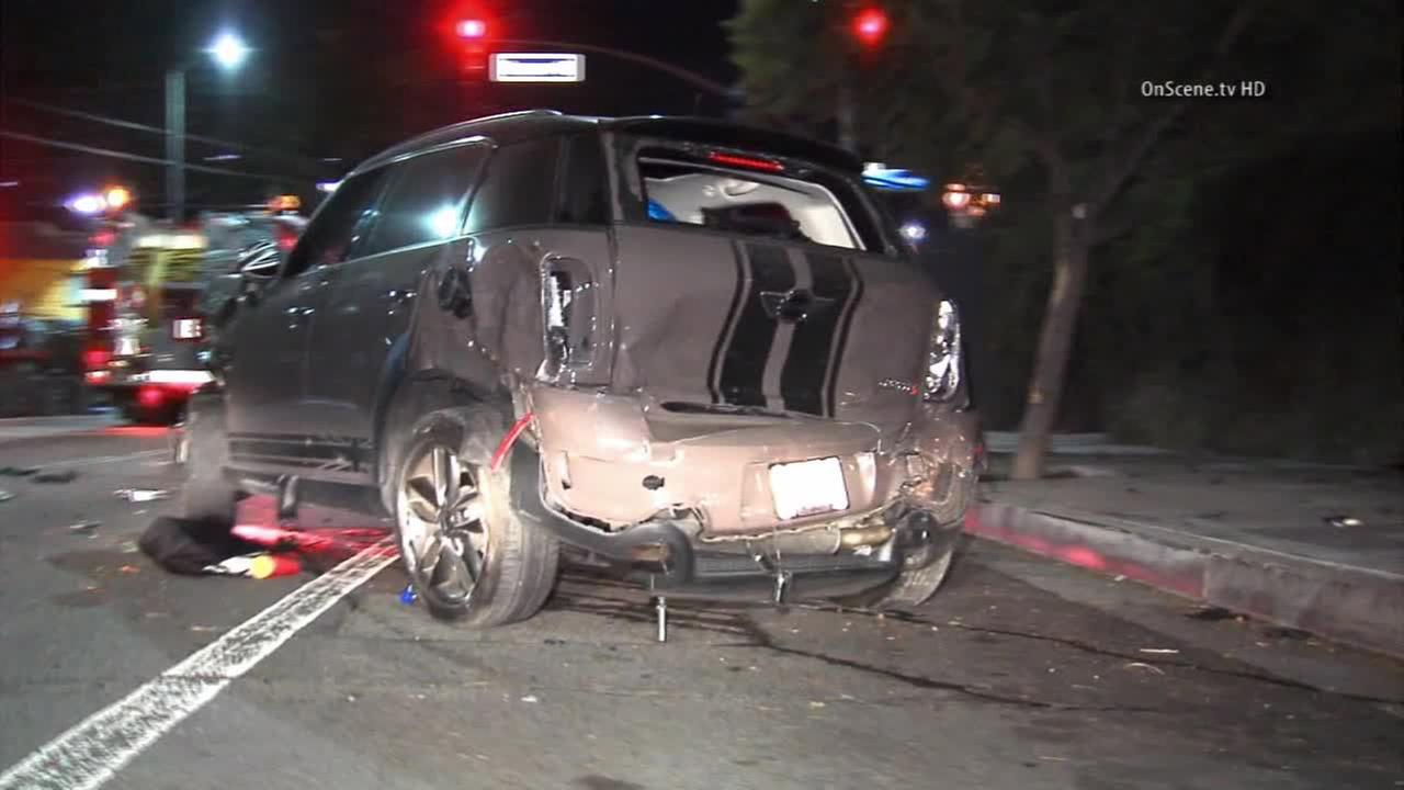 A damaged Mini Cooper is seen following a bizarre crash in Los Angeles on Monday, Nov. 17, 2014.