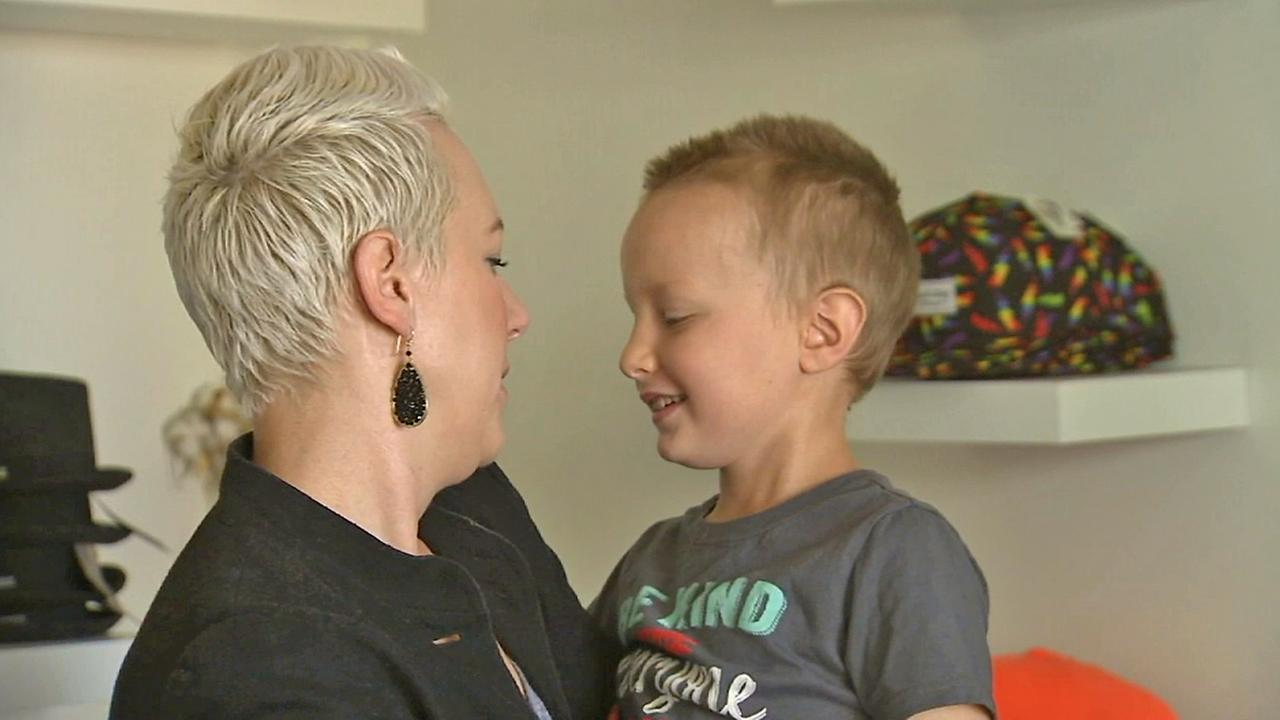 Audra DiPadova Wilford holds her 7-year-old son Max, who is battling cancer.