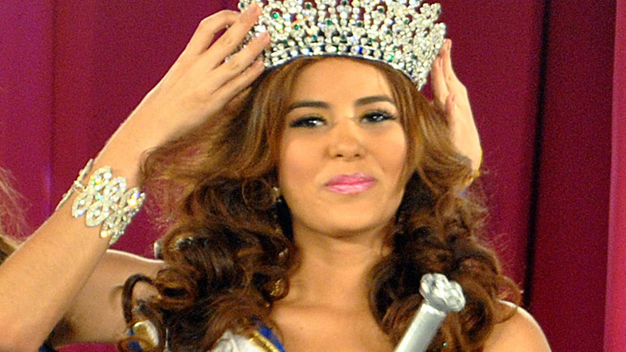 In this April 26, 2014 photo, Maria Jose Alvarado is crowned the new Miss Honduras in San Pedro, Sula, Honduras.