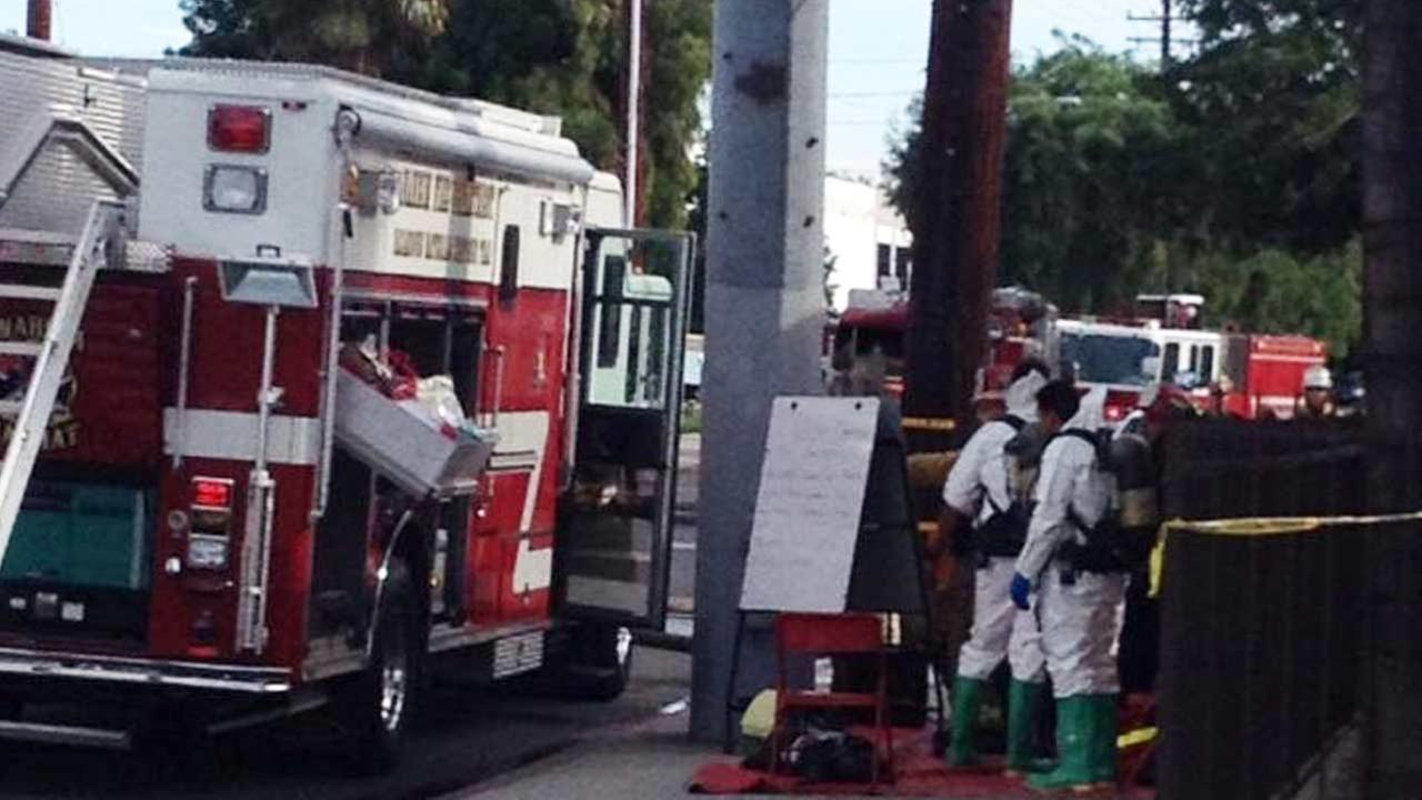 A hazmat team is shown on campus at UEI College in Anaheim following a chemical spill.