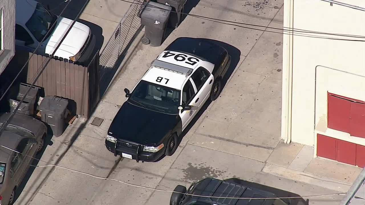 Police on scene of an officer-involved shooting in Long Beach on Friday, Nov. 21, 2014.