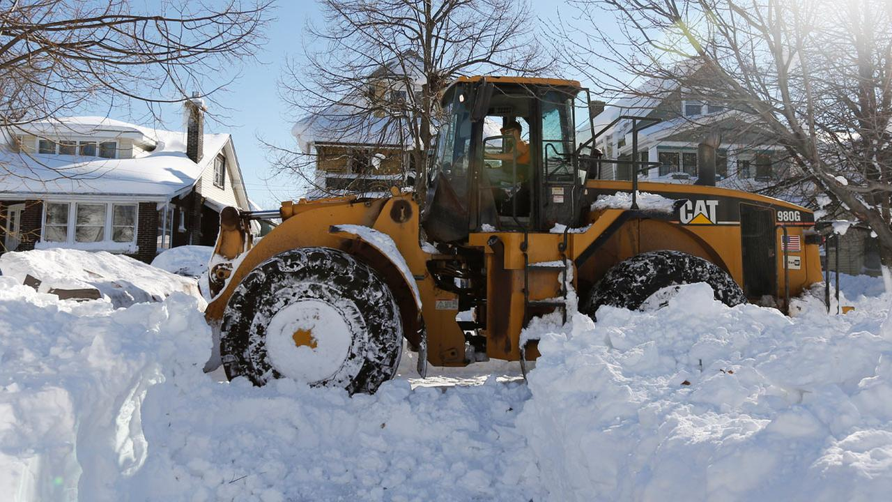 A front loader clears snowfall on Friday, Nov. 21, 2014, in that brought huge drifts and closed roads in Buffalo, N.Y.