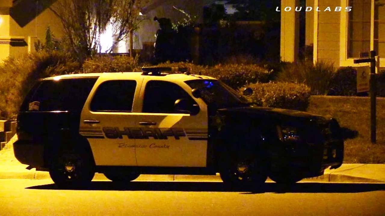A dozen homes in a Riverside County neighborhood were evacuated when a suspect in a domestic violence incident barricaded himself inside a home on Friday, Nov. 21, 2014.