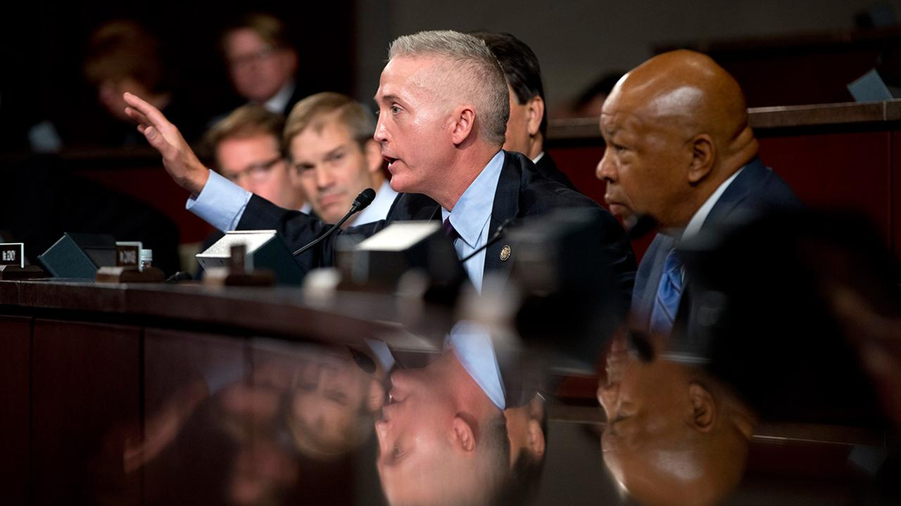 House Select Committee on Benghazi chairman Rep. Trey Gowdy, R-S.C., second from right, joined by ranking member Elijah Cummings, D-Md., right, gestures as he speaks on Capitol Hill in Washington, Wednesday, Sept. 17, 2014.