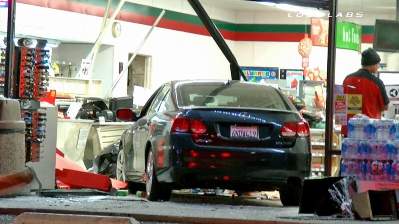 A car is seen after its driver crashed into a 7-Eleven in La Habra on Saturday, Nov. 22, 2014.