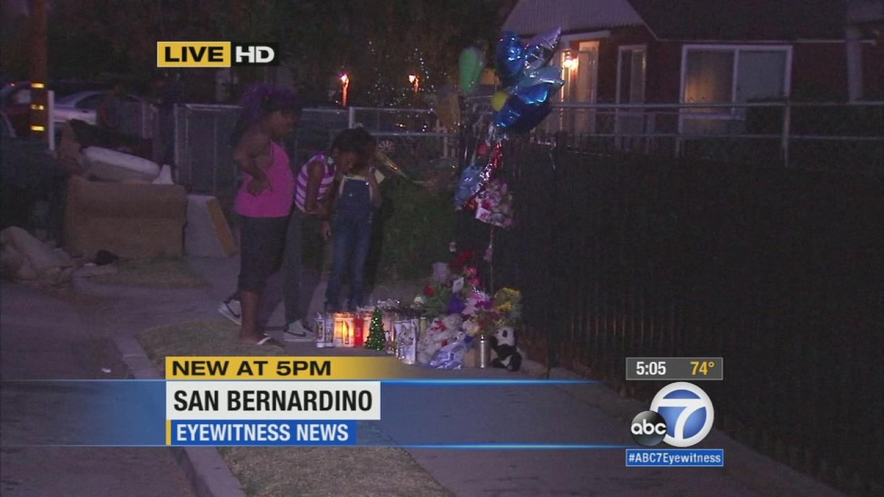 A vigil was held Sunday, Nov. 23, 2014, for two young children who were killed in a San Bernardino apartment fire.