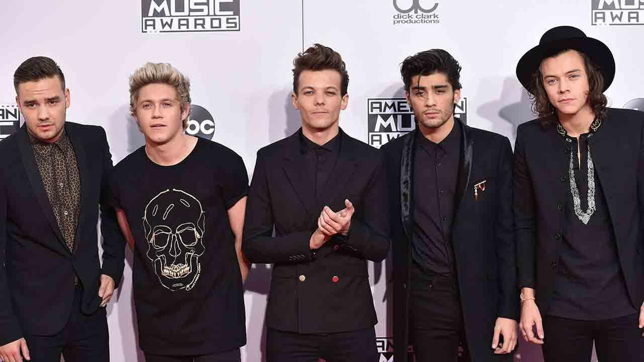 One Direction arrives at the 42nd annual American Music Awards at Nokia Theatre L.A. Live on Sunday, Nov. 23, 2014, in Los Angeles.