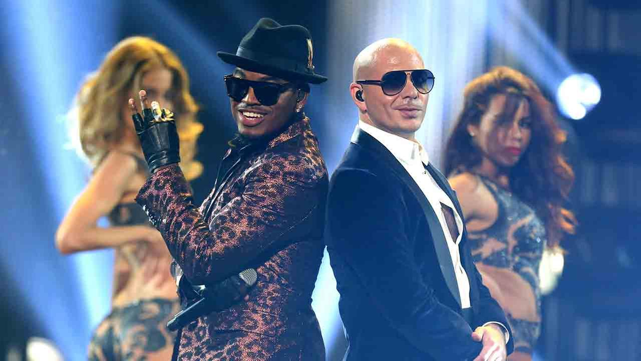 Ne-Yo, left, and Pitbull perform at the 42nd annual American Music Awards at Nokia Theatre L.A. Live on Sunday, Nov. 23, 2014, in Los Angeles.