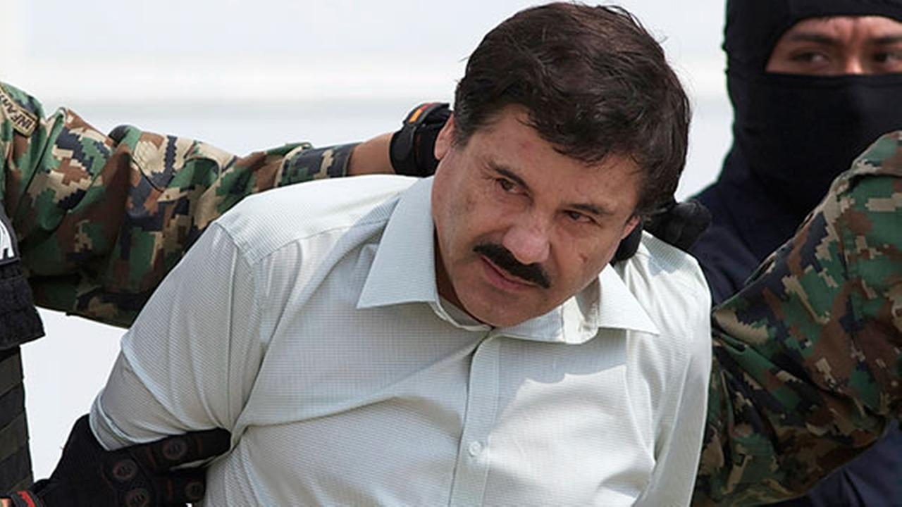 This Feb. 22, 2014 photo shows Joaquin El Chapo Guzman, the head of Mexicos Sinaloa Cartel, being taken to a helicopter in Mexico City following his capture in Mazatlan.