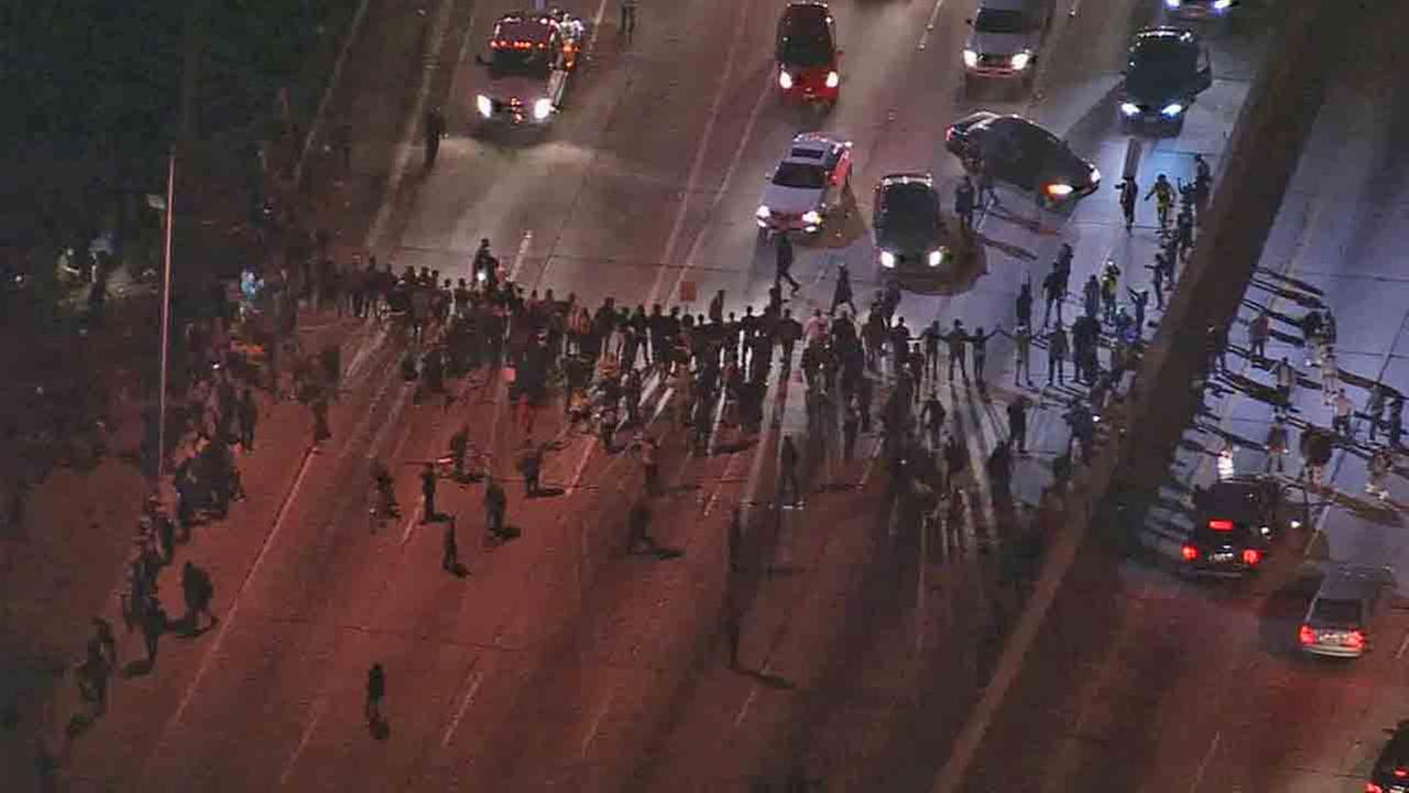 Dozens of people protesting the grand jurys decision in the fatal police shooting of Michael Brown marched onto the 110 Freeway near Pico Boulevard Monday, Nov. 24, 2014.