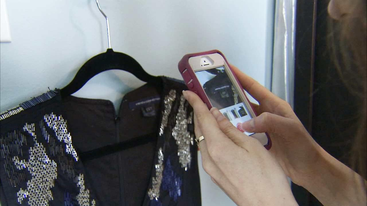 Marken Greenwood snaps a photo of a dress she wants to sell on Tradesy, an app and website that helps sell your gently used clothes and accessories for a fee.