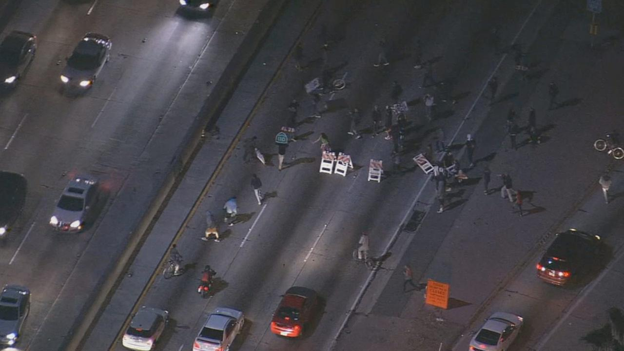Ferguson protesters spill into 101 Fwy lanes at Grand Avenue in downtown Los Angeles, Tuesday, Nov. 25, 2014.