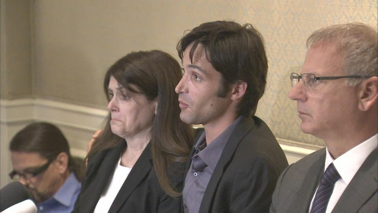 Mike Egan is seen with his mother and lawyer at a press conference on Monday, April 21, 2014.