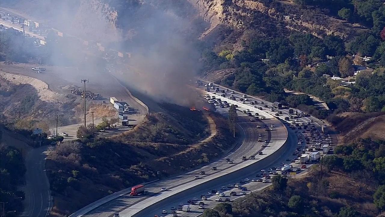 A small brush fire erupted in the Newhall Pass on the 5 Freeway just south of Calgrove on Wednesday, Nov. 26, 2014.
