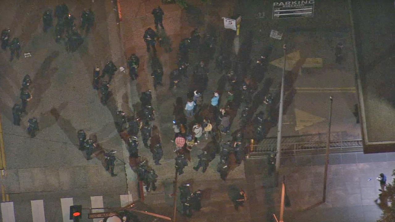 LAPD officers surround the last of about 54 protesters arrested for unlawful assembly at 6th/Hope downtown, Wed., Nov. 26, 2014.