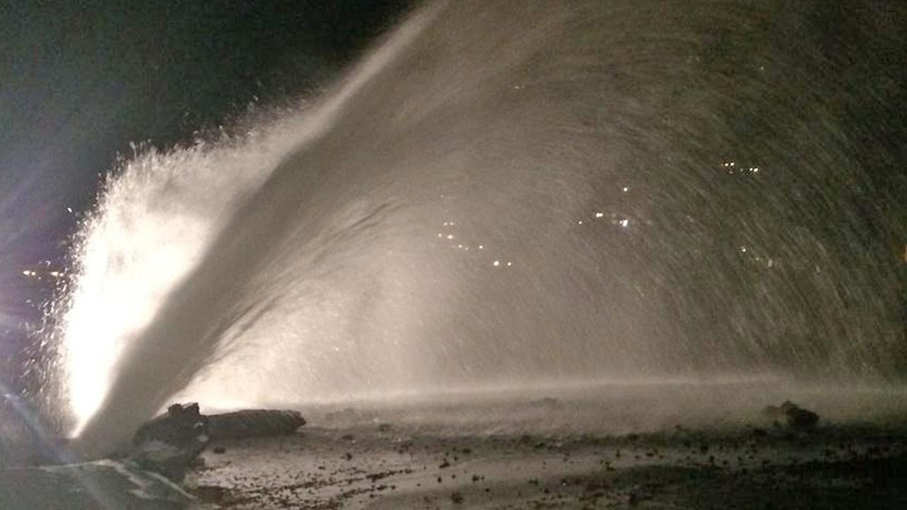 Water spews from a broken water main in Malibu on Thursday, Nov. 27, 2014.