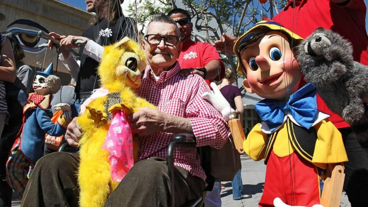 This April 6, 2014 file photo shows Bob Baker, fonder of The Bob Baker Marionette Theater, leading a parade as the Grand Marshall during the Million Puppet March in Santa Monica.