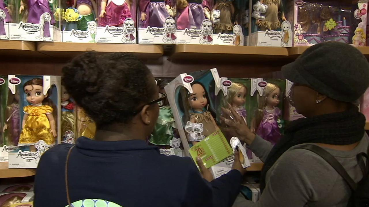 The Steen family picks out toys at the Disney store to donate to ABC7s Spark of Love toy drive.